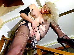 Light-haired in high heels, stretches pussy with piercings