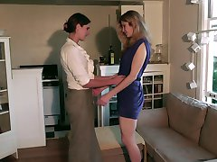 Two lesbians enjoy fingering, licking and a strap on!