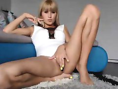 Slim Blonde Spreading Her Long Legs And Rubbing Her Pussy