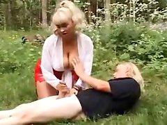 busty blonde gives handjob