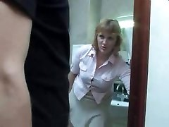 Mature mom takes a urinate on the toilet and gets interrupted by her stepson for a fuck
