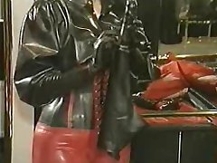 Latex Dildo pants being put on bondage girl