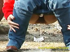 young girls peeing outdoor
