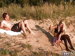 Blonde in sexy skirt outside on beach