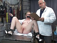 Submissive blonde gets her clit pumped by kinky master