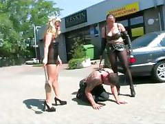 Two mistresses punish a slave in public
