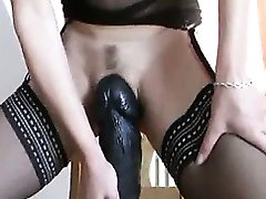 Enormous dildos stretching her loose cunt