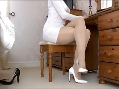 Lady Tan Pantyhose legs and white footwear .
