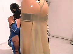Slut dressed in latex and gagged