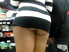 latinna ass upskirt in a public shop