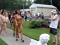 Naked women walking at nude contest