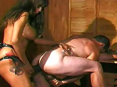 Brunette Mistress Fucks Male Slave with Strapon