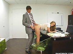 Blonde busty secretay bent over desk