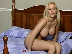 Sexy Blonde in Suntan Stocking Rides Her Dildo