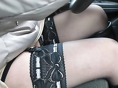 Chick flashing stockings tops in car while driving