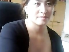 Japanese milf plays and gets caught