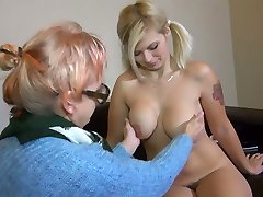 Old ugly bitch in glasses Bernadett tickles fresh pussy of pigtailed chesty gal