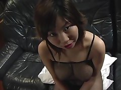 Lactating asian chick squeezes a cock between her huge boobs