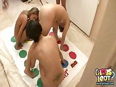 Five college girls playing naked twister