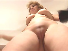 Attractive Mature lady stripping and showing off nice pussy