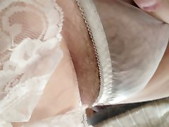 her hairy pussy in see through pantys.