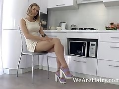 Kristinka strips in the kitchen and plays nude