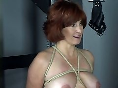 Nude redhead with cute tits and arse is whipped in bdsm dungeon