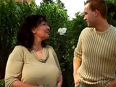 Garden granny and younger guy 03