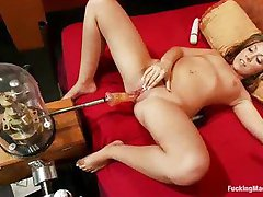 Shaved pussy girl fucked by machine