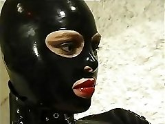 Super-hot cat woman in leather suit does anything she wants to her horny sub