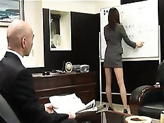 Attractive Oriental secretary with sexy long legs gives a h