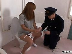Bizarre Japanese police officer getting face sat