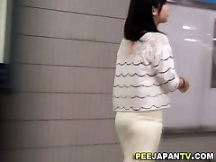Asians urinating in restroom