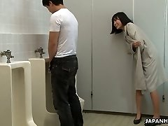 Crazy Asian chick Uta Kohaku pees on dick of one stranger dude in a public toilet