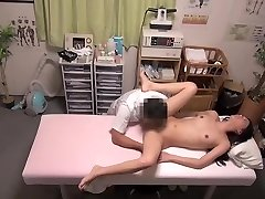 Gorgeous female gets a massage right in the clinic