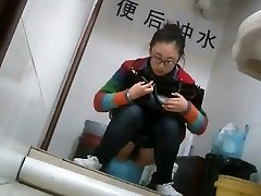 Nerdy asian doll caught taking a leak