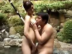 Breasty slut tearing up an Asian man in a pool
