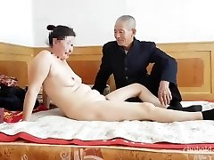 Handsome Chinese grandpa giving shagging