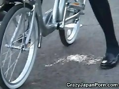College Girl Unloads on a Bike in Public!