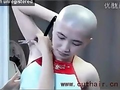 beautiful girl underarms hair bald by barber with a straight razor.