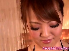 Huge-boobed japanese milf tit-screwing