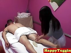 Asian masseuse with tattoos jerking