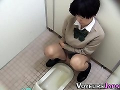 Asian teen peeing