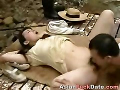 Horny Chinese husband and wife couple get frisky in the woods