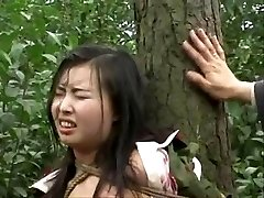 Asian army girl trussed to tree 2