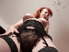 Busty mature redhead mistress plays with her vulva close up