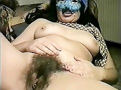 Hooded Italian COUGAR fucks herself
