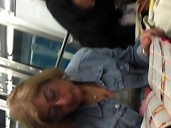 Blond mature upskirt in metro with face