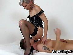 Hot stockings legs mummy Beate sitting on a stud