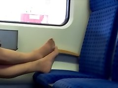 Candid Nylon feet and gams granny in train